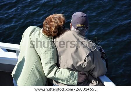 Married seniors enjoying the cruise together - stock photo