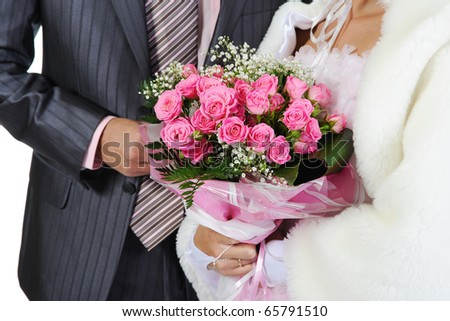 Married with a bouquet of pink roses. Isolated on white background