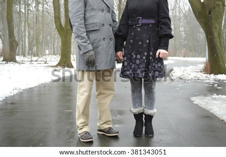 Married young loving couple holding hands each other in park, face is not visible.Couple holding hands and walking in park.hands holding together, concept of love, family, dating - stock photo