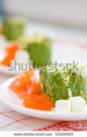 Marrow roll with a salmon and caviar - stock photo