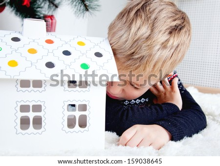 marry cristmas. Little boy laying on the floor and play - stock photo