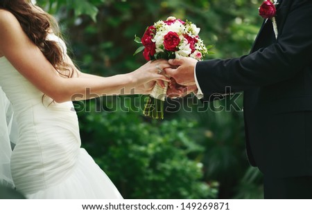 marry me today and everyday, hands of a wedding caucasian couple - stock photo