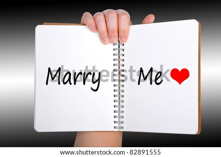 Marry me words on book