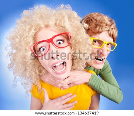 Mars and Venus collide, funny couple is having a violent argument - stock photo