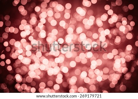Marsala background with natural bokeh defocused sparkling lights. Colorful texture with twinkling lights. Bright and vivid colors - stock photo