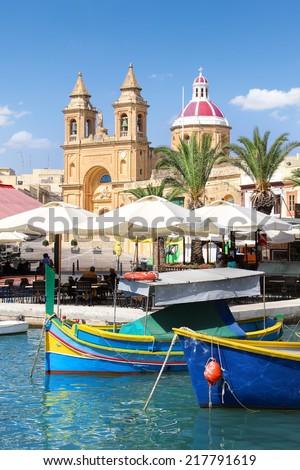 Marsaxlokk, a traditional maltese fishing village, Malta - stock photo