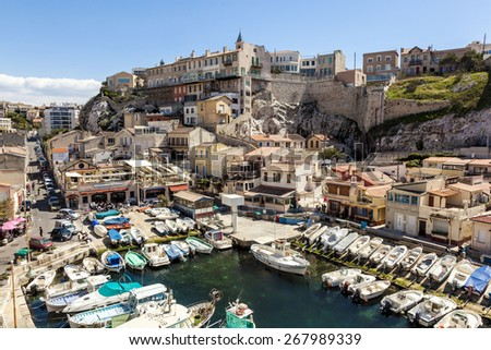 MARSEILLE, FRANCE - APR 6, 2015 : Fishemen boats in a small harbor. The Vallon des Auffes is a small fishing port of the 7eme district of Marseille, France. - stock photo
