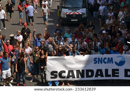 Marseille, France - June 26, 2014: Employees of the Societe nationale Corse Mediterranee (SNCM) denounce government's reforms and austerity politics.
