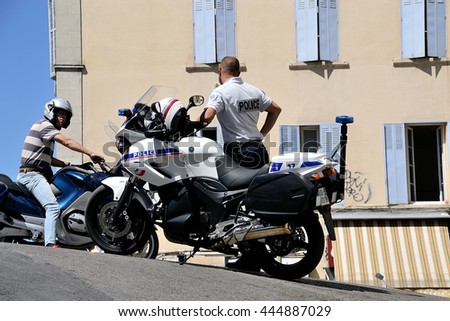 Marseille, France - June 28, 2016: French policeman with motorcycle pictured during a demonstration against the French government and planned labor law reforms