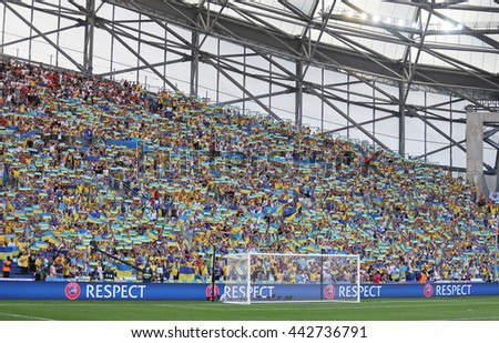 MARSEILLE, FRANCE - JUNE 21, 2016: Ukrainian fans show their support during the UEFA EURO 2016 game Ukraine v Poland at Stade Velodrome in Marseille - stock photo