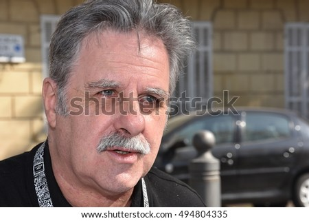 Marseille, France - October 06, 2016 : French cartoonist Alain Roche alias Nalair at the 5th edition of the International festival of press and political cartoons at l'Estaque.