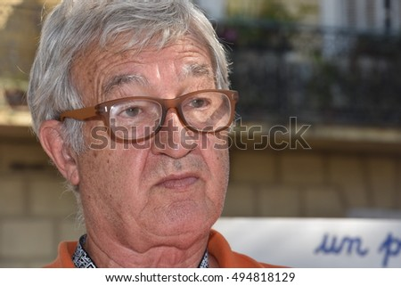 Marseille, France - October 06, 2016 : French cartoonist Batti Manfruelli at the 5th edition of the International festival of press and political cartoons at l'Estaque.