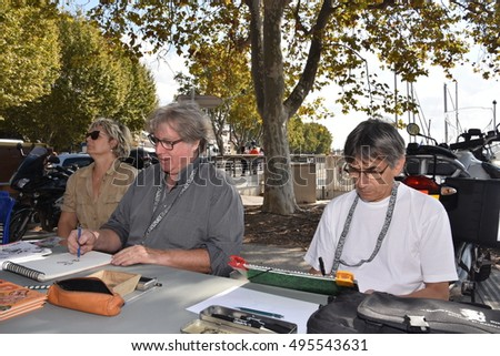 Marseille, France - October 06, 2016 : French cartoonists Jean-Michel Renault and Jean-Paul Vomorin at the 5th edition of the International festival of press and political cartoons at l'Estaque.