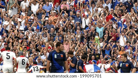 MARSEILLE, FRANCE-SEPTEMBER 30, 2007: rugby fans cheering during the Rugby World Cup match France vs Georgia, in Marseille. - stock photo