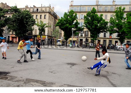 MARSEILLE - MAY 09 2008:French youth play informal football match in Marseille, France.It is played by 250 million players in over 200 countries, making it the world's most popular sport. - stock photo