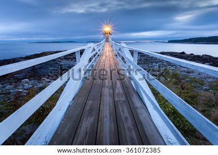 Marshall Point Lighthouse after sunset, Port Clyde, Maine, USA - stock photo
