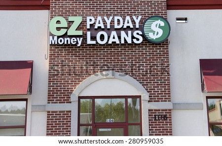 Marshfield Wisconsin, May, 22, 2015  Payday Loans Sign on a building Store Front. Payday Loans is a high interest service providing loans to high risk clients. - stock photo