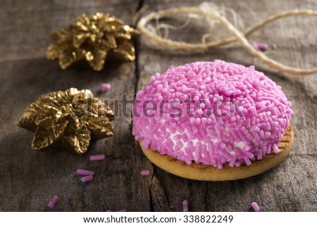 Marshmallow cookie with pink sprinkles on top and Christmas Ornaments - stock photo