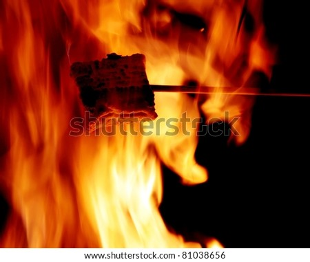 marshmallow in the flame - stock photo