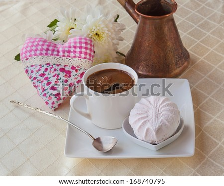 Marshmallow with a cup of hot coffee early in the morning - stock photo