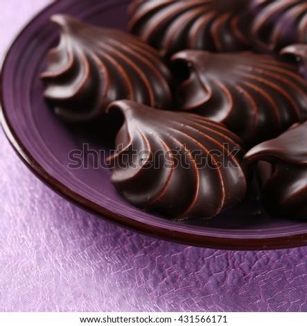 Marshmallows in chocolate - stock photo