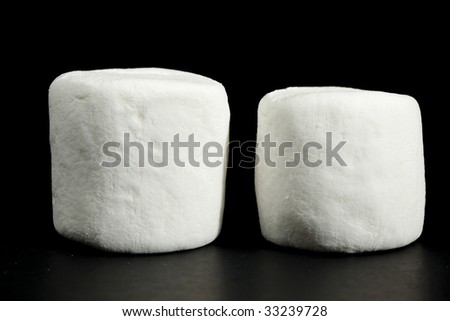 marshmellows against black background - stock photo