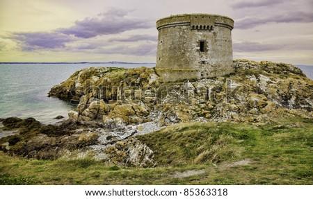 Martello tower on Ireland's eye island at sunset, Ireland. - stock photo