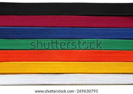 Martial Art belts in seven colors background - stock photo