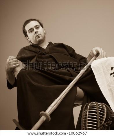 martial art concept portrait Kendo master with helmet and sword - stock photo