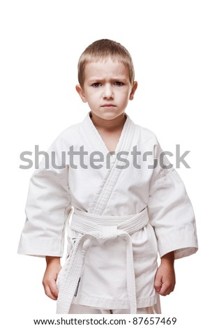 Martial art sport - child boy in white karate training kimono - stock photo