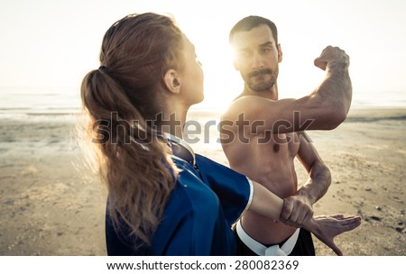 martial art training on the beach. concept about fighting,fitness and people - stock photo