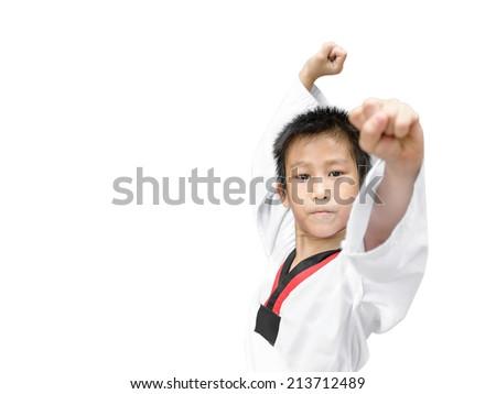 martial arts boy in kimono excercising karate kata - stock photo