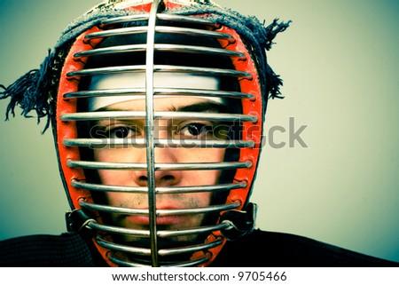 martial arts concept portrait Man in kendo helmet - stock photo