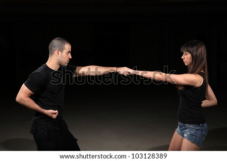 martial arts instructor exercising with young girl - stock photo