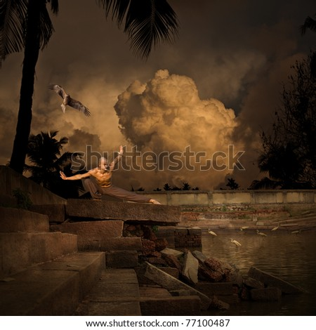 Martial Arts Sport Training in the Ruins of an Ancient Temple Pool - stock photo