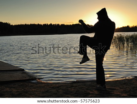 Martial arts training in the sunset time - stock photo