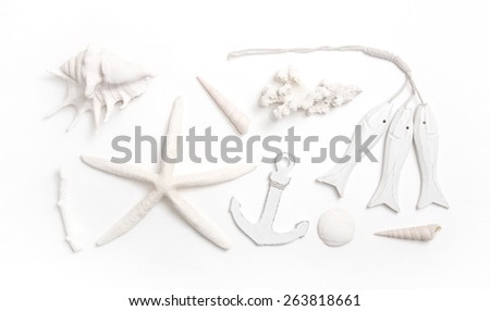 Martime decoration in white with starfish, shells and anchor. - stock photo