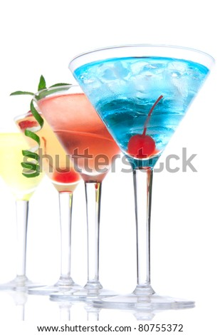 Martini alcohol cocktails in row  blue hawaiian, tequila sunrise, garnished with cherry, lime, mint in martinis cocktail glasses on a white background - stock photo