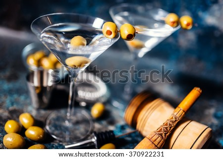 Martini, classic cocktail with olives, vodka and gin served cold in a restaurant - stock photo