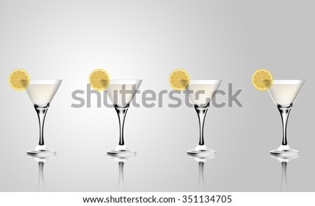 Martini cocktail glass with lemon. Realistic mixed alcoholic beverage. - stock photo
