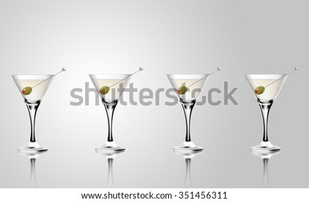 Martini cocktail glass with olives. Realistic mixed alcoholic beverage. - stock photo