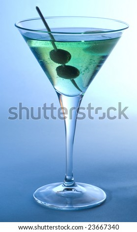 Martini cocktail with olives and  blue background