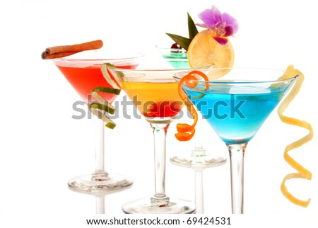 Martini cocktails composition with vodka, light rum, gin, tequila, blue curacao, lime juice, lemonade, lemon wheel and tropical orchid in classic cocktail glasses isolated on a white background - stock photo