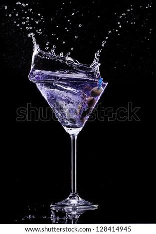 Martini drink isolated on black background - stock photo