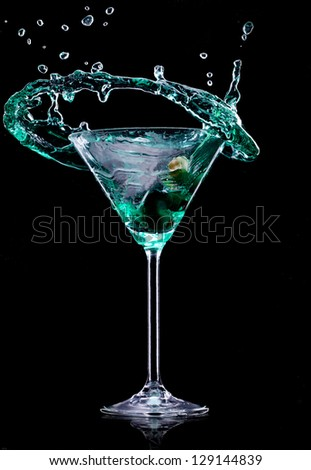 Martini drink over dark background - stock photo