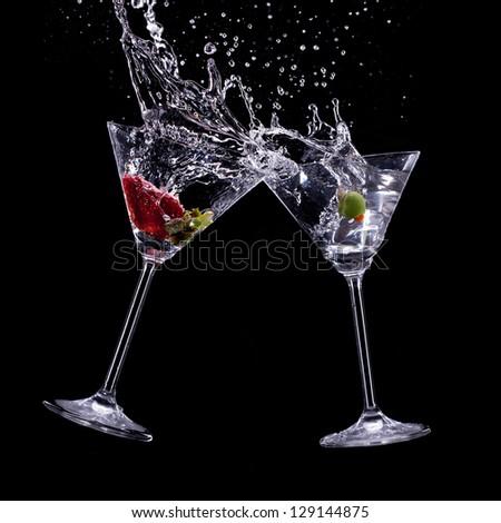 martini drinks over dark background - stock photo