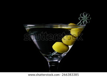 Martini glass and olives isolated on black. design element - stock photo