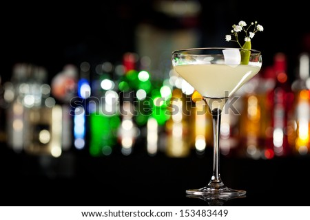 Martini Glass of Cocktail with Apple Slice - stock photo