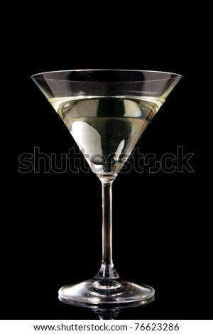 Martini glass on black background - stock photo
