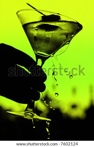 martini glass on green background
